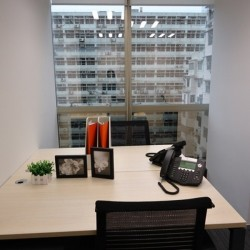 Room of business center. Double workstations. Office furniture provided. Modern design. (China Minmetals Tower)