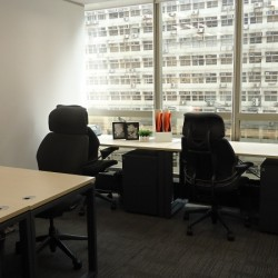 Room of business center. Multiple workstations. Office furniture provided. Abundant natural light. (China Minmetals Tower)