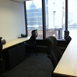 Office area of business center. Multiple workstations. Office furniture provided. Abundant natural light. (Worldwide House)