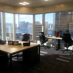Layout of business center. Multiple workstations. Stunning sea view and city view. Modern and efficient design. Office furniture provided. Central Air-Conditioning. (Cheung Kong Center)