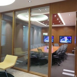 Commodious conference room in business center. Modern design with office furniture provided. Equipped with teleconference facilities and a TV. (Cheung Kong Center)