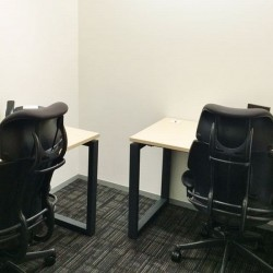 Room of business center. Multiple workstations. Office furniture provided. (Champion Tower)