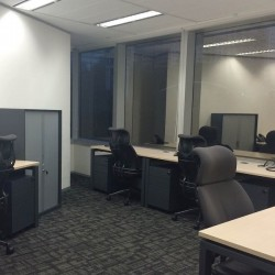 Office area of business center. Multiple workstations. Office furniture provided. Abundant natural light. (Champion Tower)