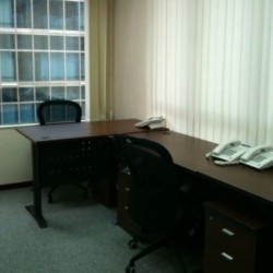 Room of business center. Double workstations. Office furniture provided. Abundant natural light. (80 Gloucester Road)