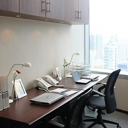 Room of business center. Double workstations. Office furniture provided. Modern design. Abundant natural light. (Langham Plaza Office Tower)