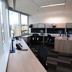 Efficient layout design of the business center. Multiple workstations. (Times Square Tower Two)