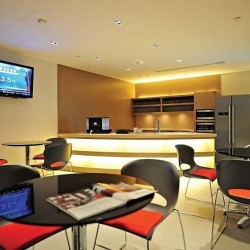 Pantry of business center. Break-out area. Contemporary design with superior office furniture. Equipped with snack vending machine, fridge, TV and microwave oven. (Times Square Tower Two)