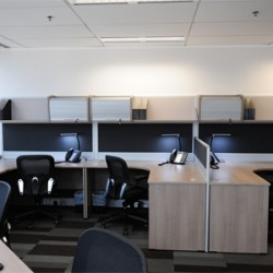 Layout of business center. Multiple workstations. Modern and efficient design. Office furniture provided. Central Air-Conditioning. (Times Square Tower Two)