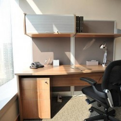 Office area of business center. Single workstation. Abundant natural light. (Millennium City 5 – BEA Tower)