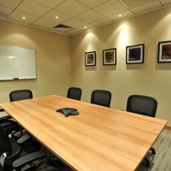 Conference room of business center. Equipped with teleconference facilities and a whiteboard on wall. Office furniture of high quality provided. Contemporary design. (Millennium City 5 – BEA Tower)