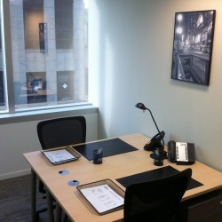 Room of business center. Double workstations. Office furniture provided. Abundant natural light. (Times Square Tower One)