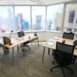 Room of business center. Multiple workstations. Magnificent city and harbour view. Office furniture provided. (Times Square Tower One)
