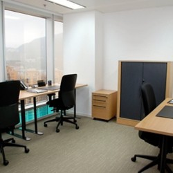 Room of business center. Multiple workstations. Office furniture provided. Abundant natural light. (The Lee Gardens)