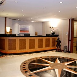 Reception of business center. Glamorous and stylish. Central air-conditioning. Office furniture provided. (Central Plaza)