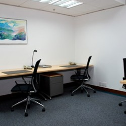 Room of business center. Multiple workstations. Office furniture provided. (Central Plaza)