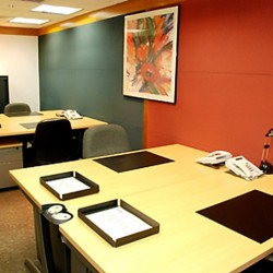 Office area of business center. Multiple workstations. Stylish. Office furniture provided. (Shui On Centre)