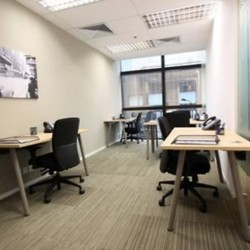 Room of business center. Multiple workstations. Stylish. Office furniture provided. (Miramar Tower)