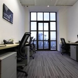 Another room of business center. Multiple workstations. Splendid city view. Office furniture provided. Abundant natural light. (Entertainment Building)