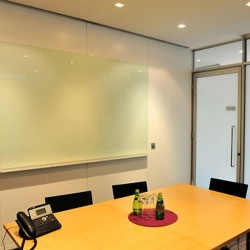 Another conference room of business center. Efficient layout. Equipped with teleconference facilities and a whiteboard on wall. Office furniture provided. (Entertainment Building)