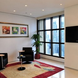 Lounge area. Stylish design with prime office furniture. City view of Central. Equipped with a TV. (Entertainment Building)