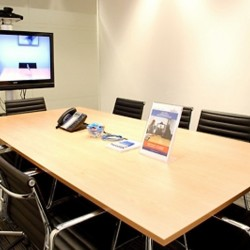 Another conference room of business center. Commodious and trendy. Equipped with teleconference facilities and a TV. Office furniture of high quality provided. (One International Finance Centre)