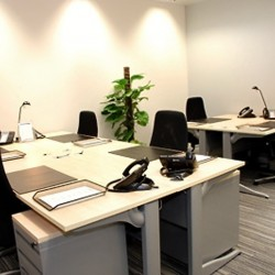 Another office area of business center. Multiple workstations. Office furniture provided. (One International Finance Centre)