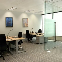 Office area of business center. Multiple workstations. Office furniture provided. Abundant natural light. (One International Finance Centre)