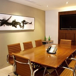 Conference room of business center. Efficient layout. Equipped with teleconference facilities and a TV. Office furniture of high quality provided. (The Center)