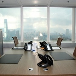 Room of business center. Double workstations. Extraordinary harbour view. Superior office furniture provided. Abundant natural light. (The Center)