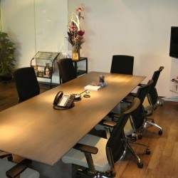 Conference room of business center. Chic and modern. Equipped with teleconference facilities, a TV and newspaper stand. Office furniture of high quality provided. (International Commerce Centre)