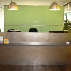 Reception along with lounge area. Chic and unconventional. Central air-conditioning. Office furniture provided. (International Commerce Centre)