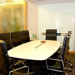 Another conference room of business center. Equipped with a whiteboard on wall. Office furniture provided. (The Lee Gardens