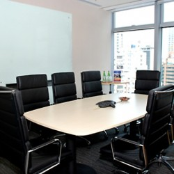 Conference room of business center. Office furniture provided. Equipped with teleconference facilities and a whiteboard on wall. (100 Queen's Road Central)
