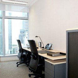 Room of business center. Multiple workstations. Office furniture provided. Abundant natural light. (100 Queen's Road Central)