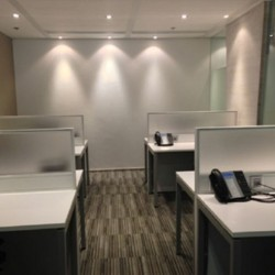 Room of business center. Multiple workstations. Office furniture provided. (China Resources Building)