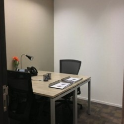 Room of business center. Double workstations. Office furniture provided. (China Resources Building)