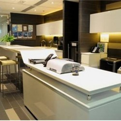 Lounge area. Office furniture: Photocopier, giant stapler and cabinet. (Dah Chong Hong Commercial Centre)