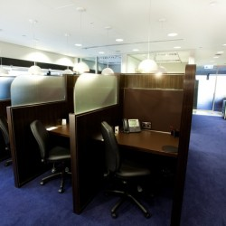 Office area of business center. Multiple workstations. Office furniture provided. (Hong Kong Club Building)