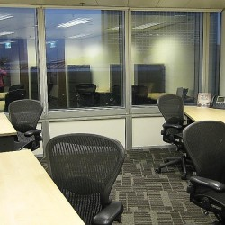Room of business center. Multiple workstations. Abundant natural light. Office furniture provided. (Exchange Square Block Two)