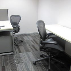 Room of business center. Double workstations. Office furniture provided. Central Air-Conditioning. (Nexxus Building)