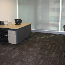 Room of business center. Multiple workstations. Office furniture provided. Abundant natural light. (Three Pacific Place)
