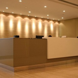Reception of business center. Contemporary design. Central Air-Conditioning. Office furniture provided. (Wheelock House)