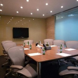 Another conference room of business center. Commodious and equipped with a fridge and video conferencing facilities. Office furniture provided. (Wheelock House)