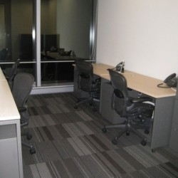 Another room of business center. Multiple workstation. Office furniture provided. Abundant natural light. Central Air-Conditioning. (One Island East)