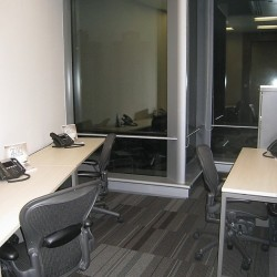 Office area of business center. Multiple workstations. Office furniture provided. Abundant natural light. (One Island East)