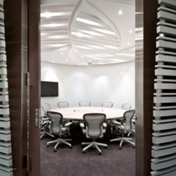 Conference room of business center. Chic and modern. Equipped with a TV. Office furniture of high quality provided. (One Island East)