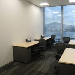 Room of business center. Multiple workstations. Stunning unobstructed sea view. Office furniture provided. (One Island East)