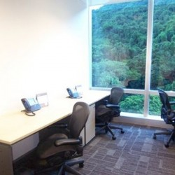 Office area of business center. Multiple workstations. Green view of Hong Kong. Office furniture provided. Abundant natural light. (Cambridge House)