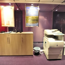 Office equipment: photocopier and giant stapler. (Wheelock House)