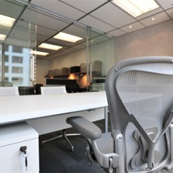 Room of business center. Single workstation. Office furniture provided. (Wheelock House)